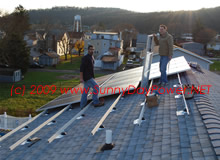 Solar Panels Getting Installed on UniRac Rails with Mounts Flashed into New Roof.